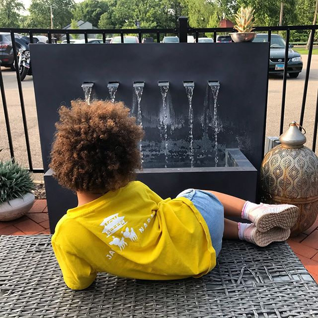 Watching and listening to the water fountain, while waiting for her fish tacos. #olivesanyu