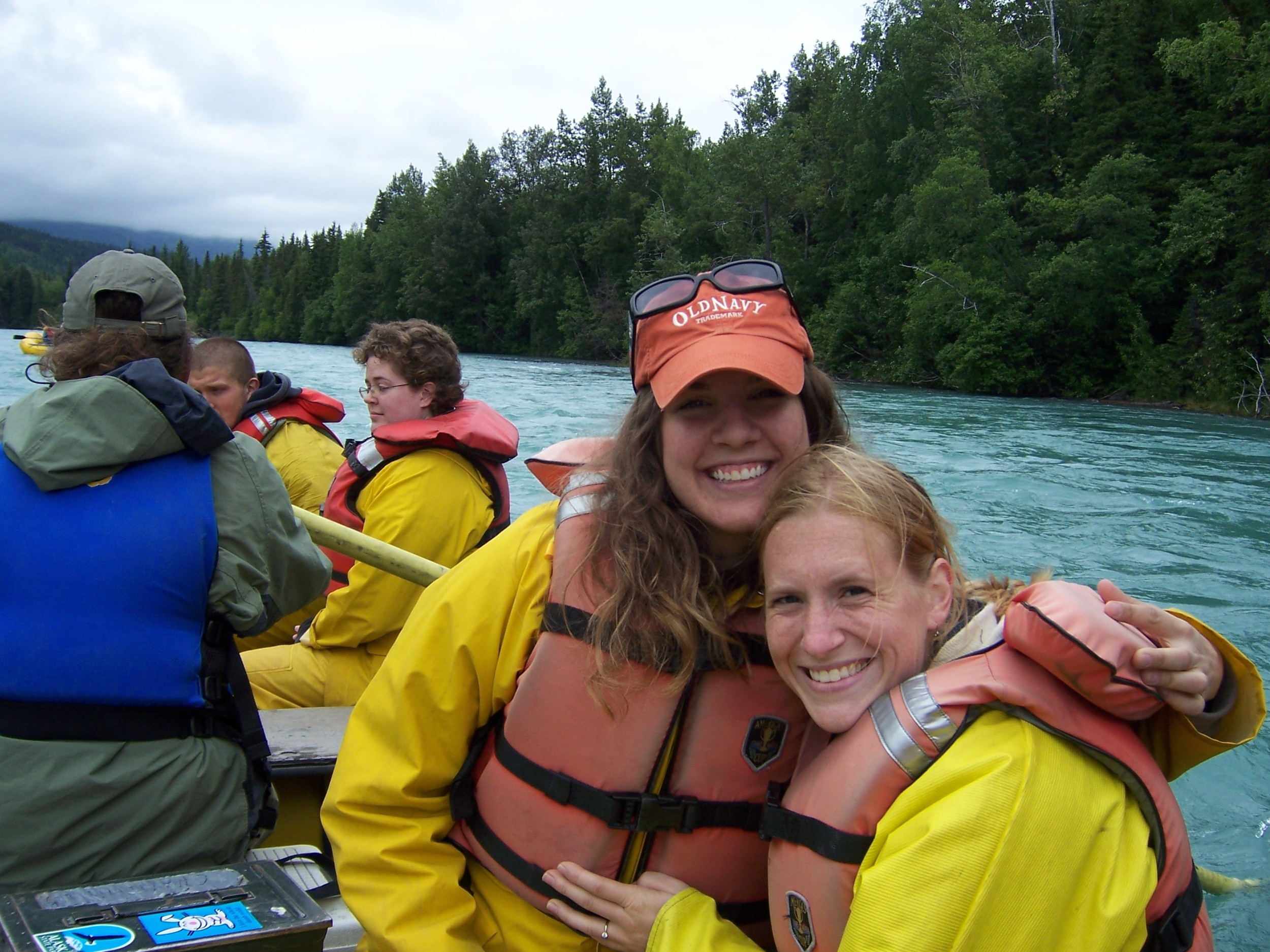 "Me and Jess sporting some serious safety gear on a rafting trip down the Kenai River. I was mentoring her on the appropriate response to a bear sighting, which, incidentally, is  not  to point and yell ""Bear!"" Which we did. About 5 minutes after this picture was taken."