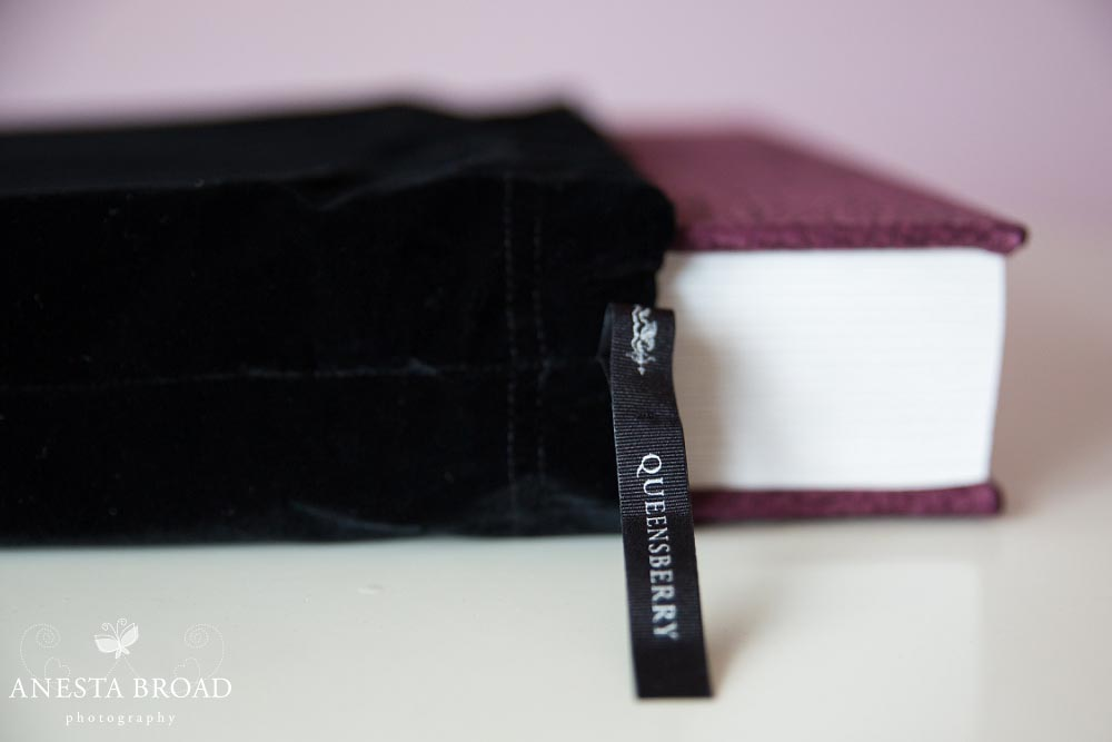 Albums are protected inside a velvet bag.
