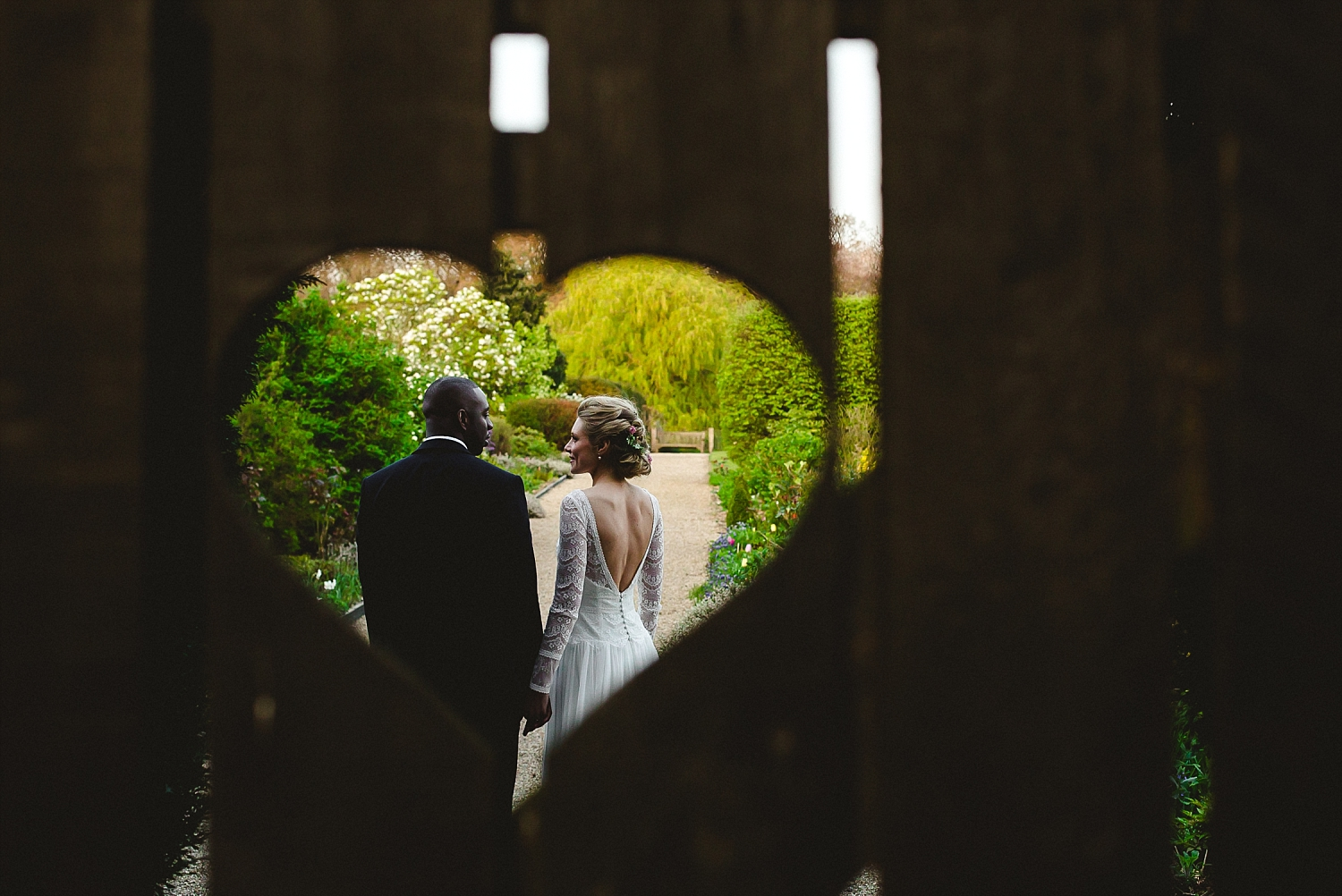 Gaynes Park Wedding Photographer - Portrait at the kissing gate