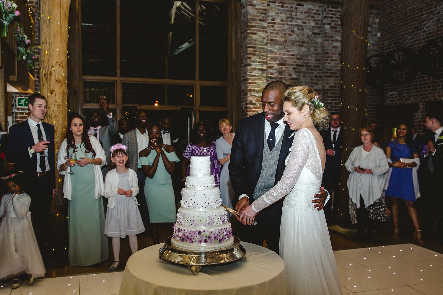Gaynes Park Wedding Photographer - Cake Cutting on the Dancefloor