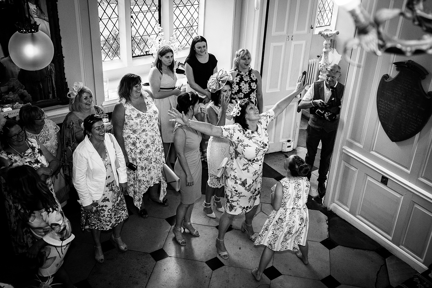 Gosfield Hall Essex Wedding - Bride Throwing the Bouquet