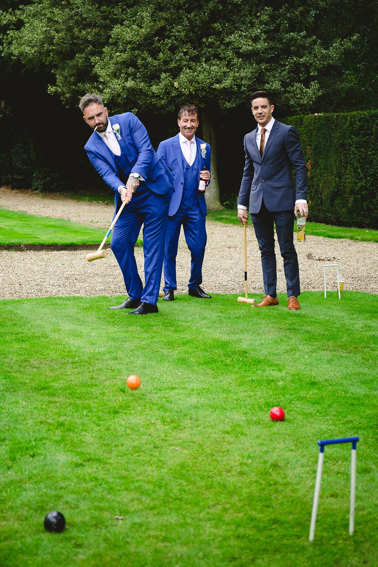 Gosfield Hall Wedding Photography - Groom's Party playing Croquet