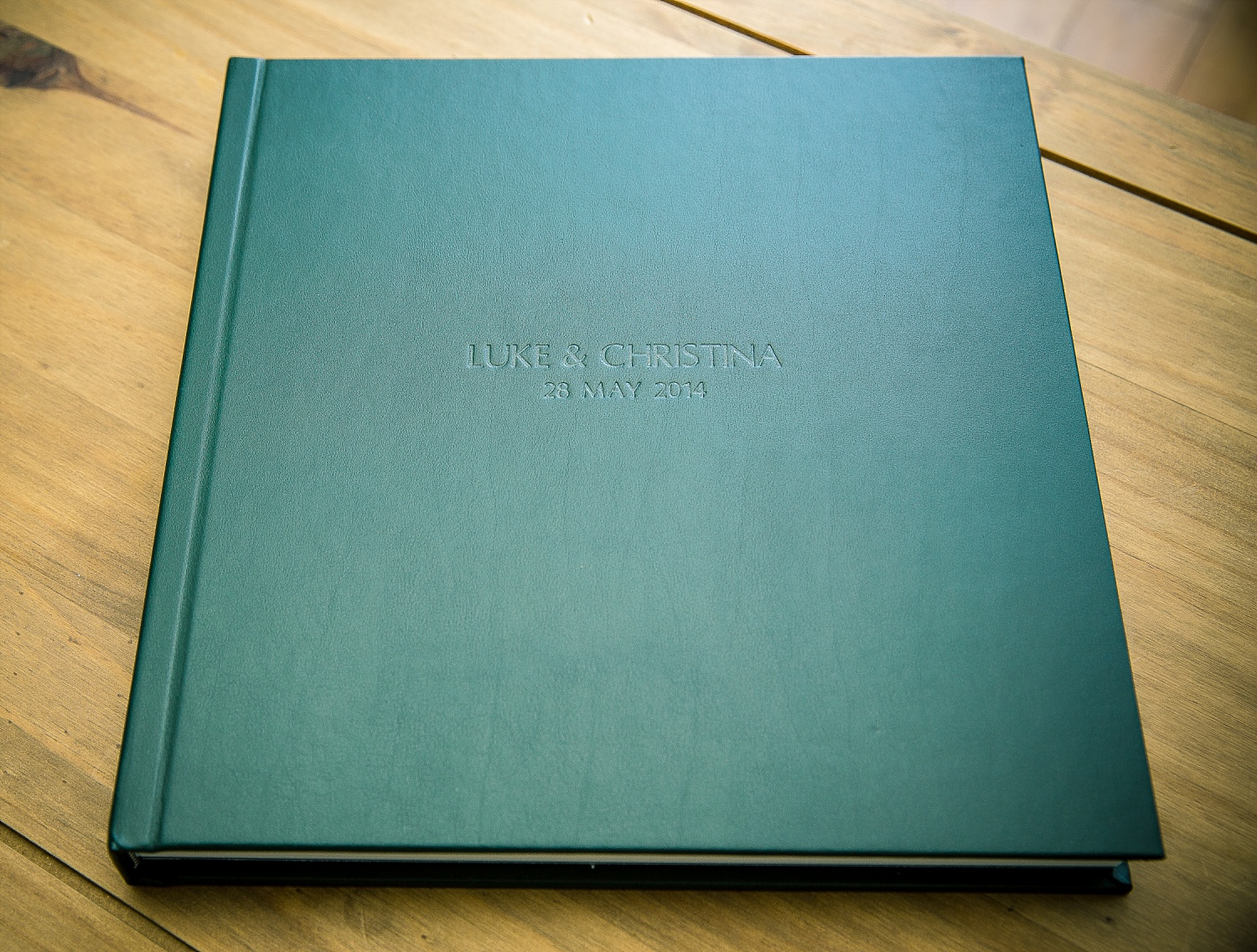 Green leather album cover with blind embossing