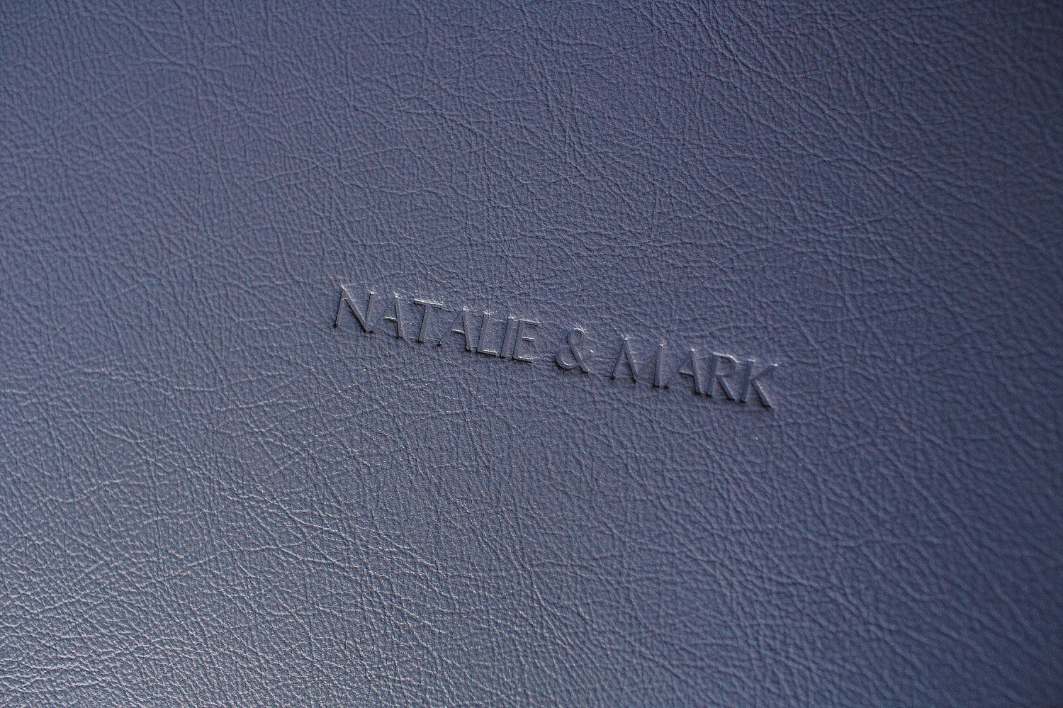 Blue leather album cover with blind embossing