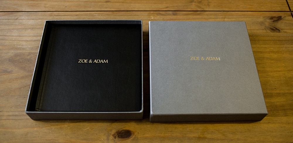 Black leather wedding album with gold embossing