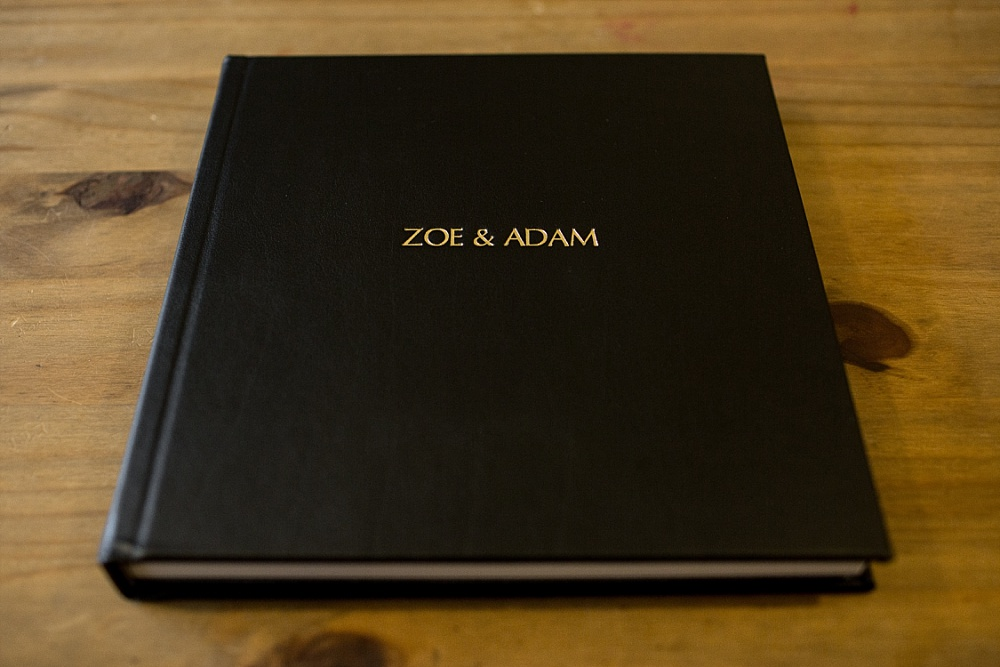 Black leather album cover with gold embossing