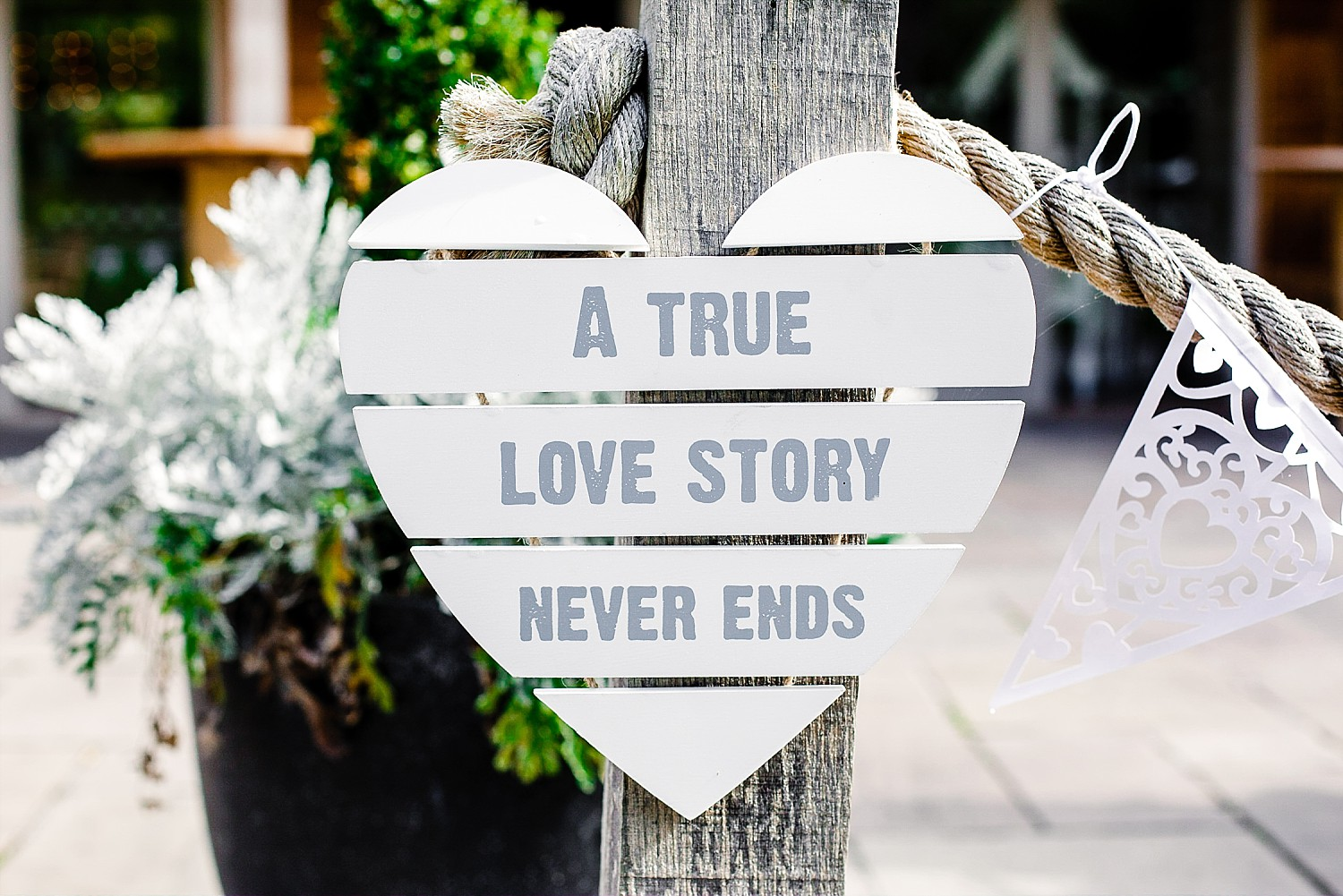 A True Love Story Never Ends Sign at Houchins Wedding Venue