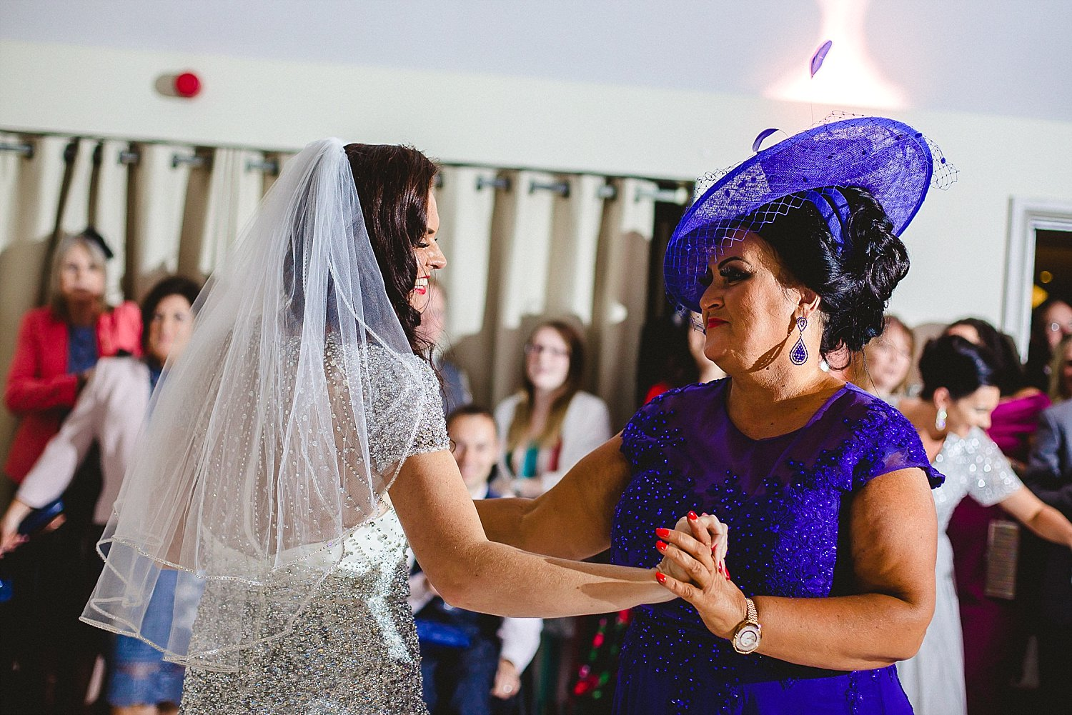 Houchins Essex Wedding Photographer - Bride and mother of the bride dancing