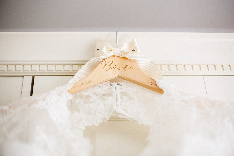 Moor Hall Essex Wedding Photographer - Bridal Gown on Bespoke Hanger
