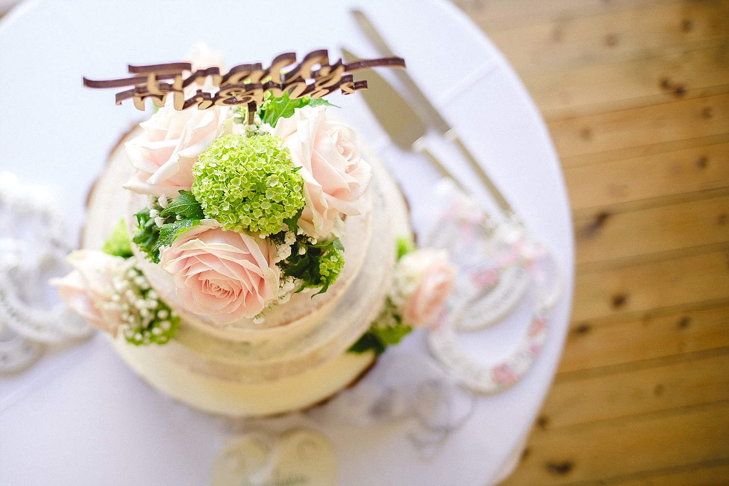 Moor Hall Wedding Photographer - Wedding Cake with floral decoration