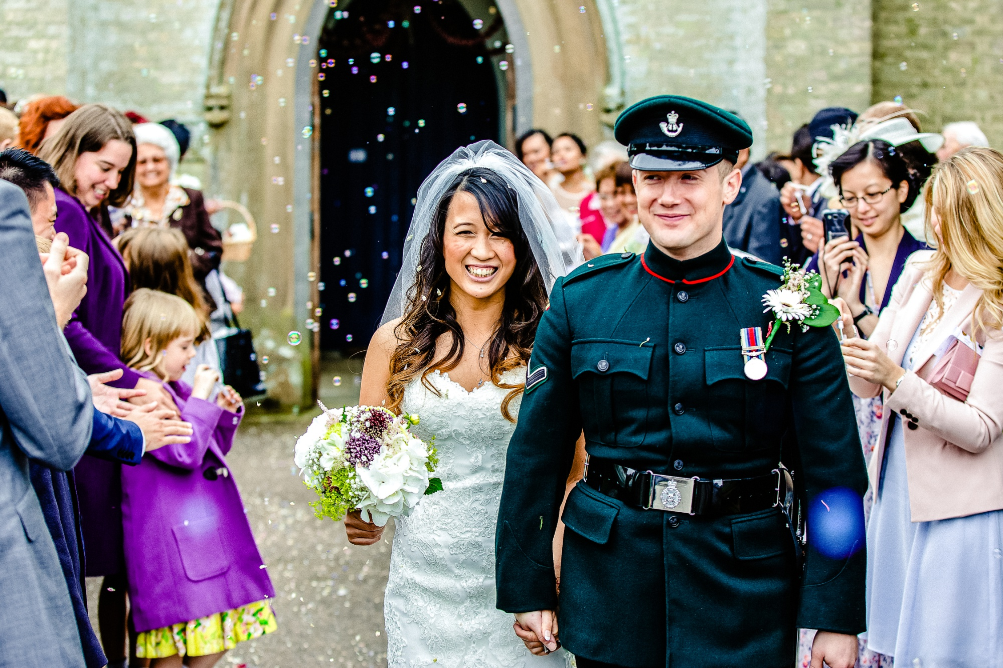 BUBBLES AND CONFETTI AT ST GERMAIN CHURCH NEAR BLAKE HALL ESSEX