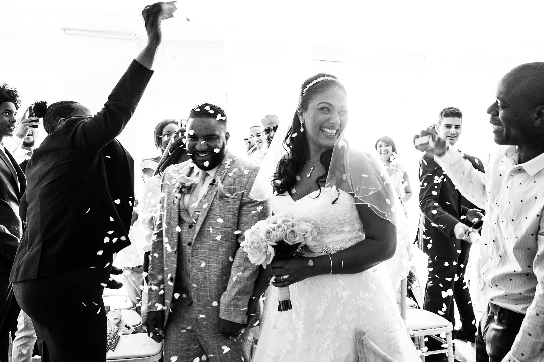 CONFETTI INDOORS AFTER THE CEREMONY AT PARKLANDS QUENDON HALL ESSEX