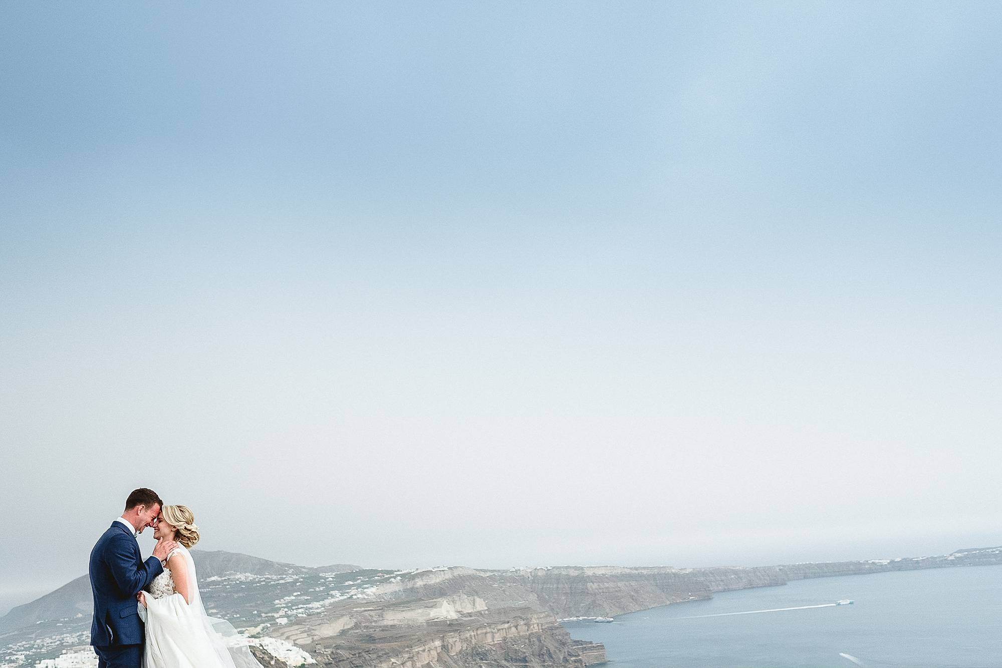 HANNAH & ELLIOTT'S DESTINATION WEDDING IN the scenic hills of SANTORINI greece