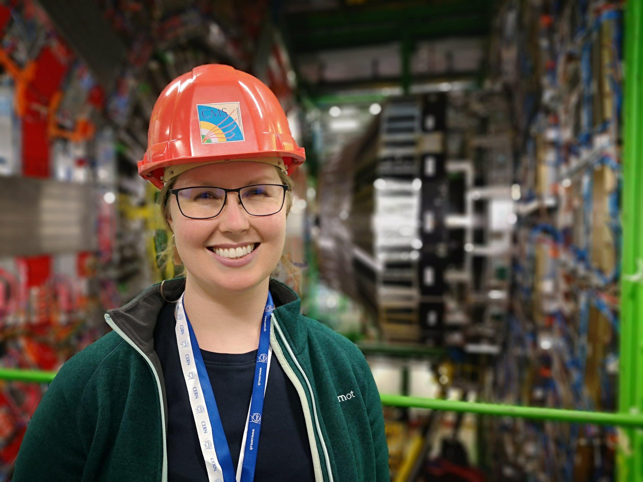 Katherine Kornei in front of CERN's Compact Muon Solenoid CMS detector.jpg