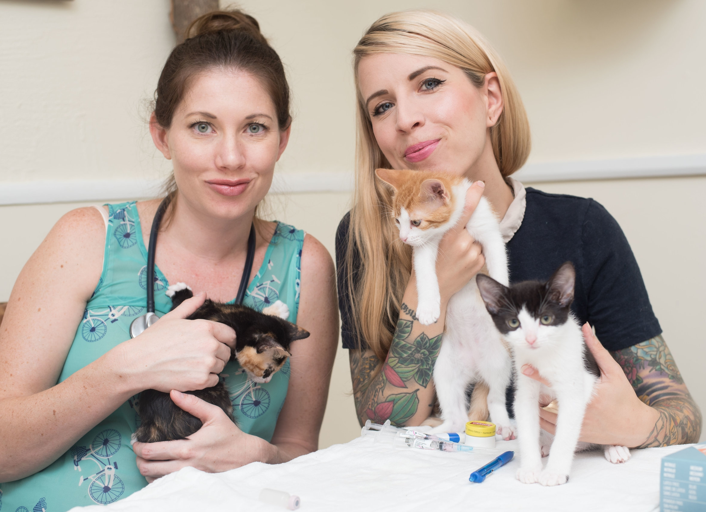 Dr. Erica and Hannah with kittens Bandit, Squeaky, and Bear.