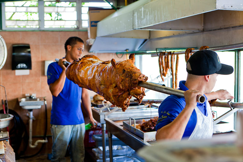 "Replenishing the pork on the spit at lechonera ""Los Pinos"".  ©2010 John Slemp"