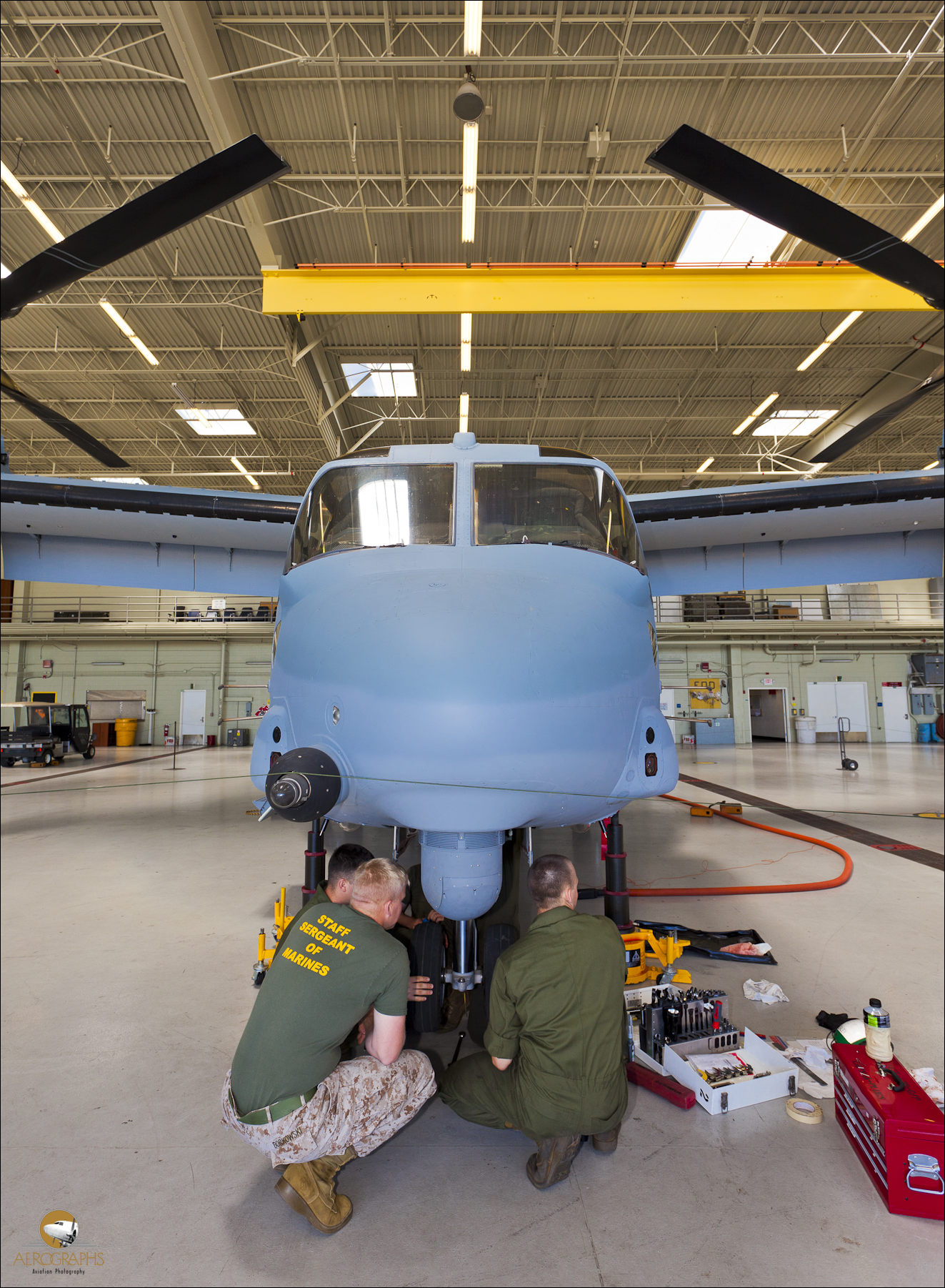 Marine mechanics work on an Osprey at MCAS Miramar near San Diego, California.