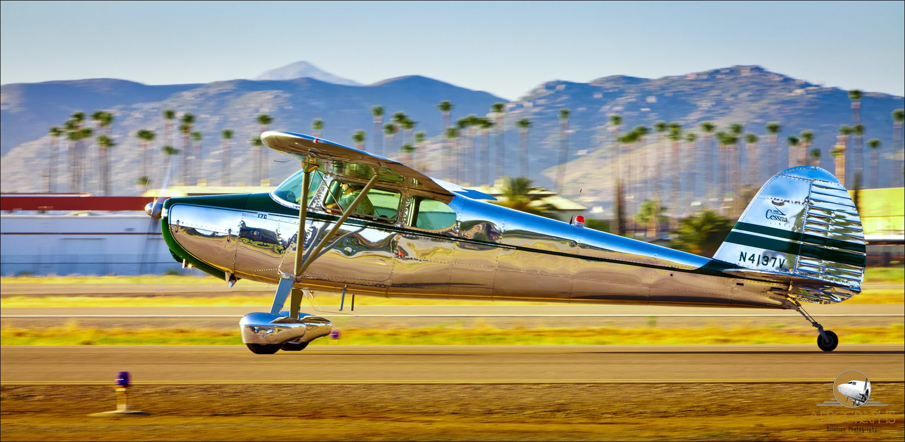 A highly polished Cessna 170 taxis by at Gillespie Field, El Cajon, California.