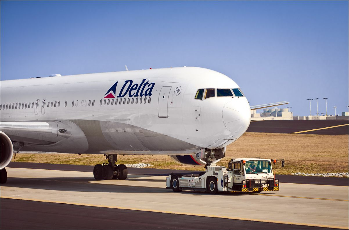A Delta Air Lines Boeing 767-332 (ER) (WL) being towed at Hartsfield-Jackson Atlanta International Airport.