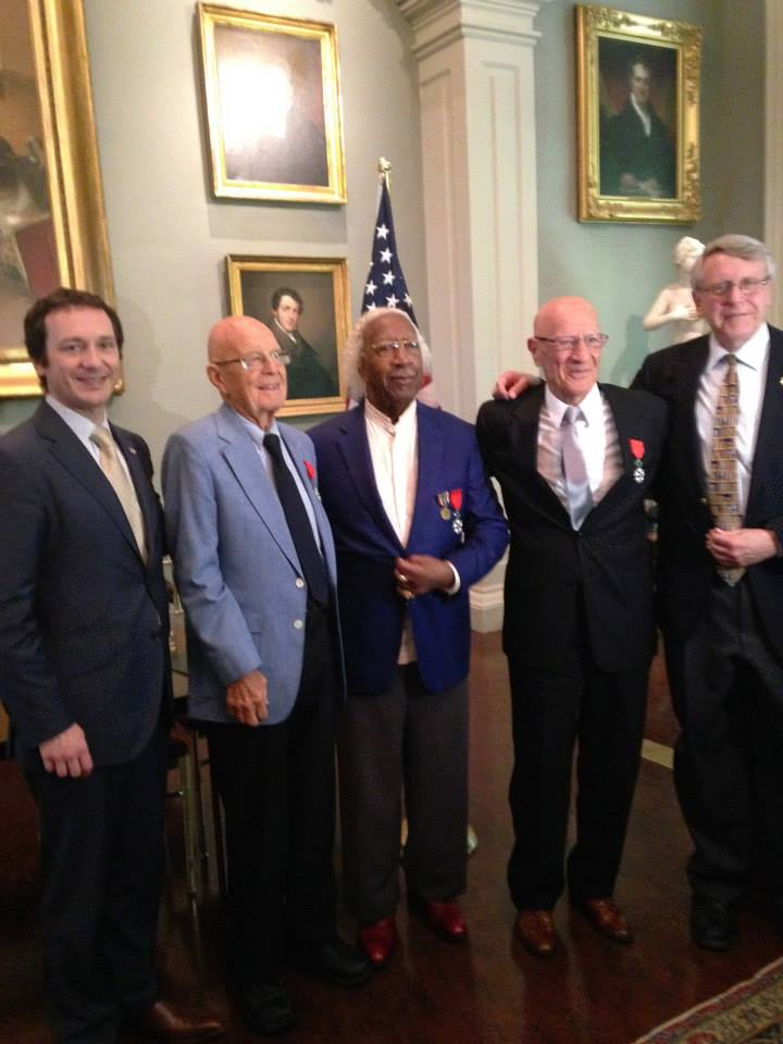 The Consul General and Hoffman with three WWII Veterans