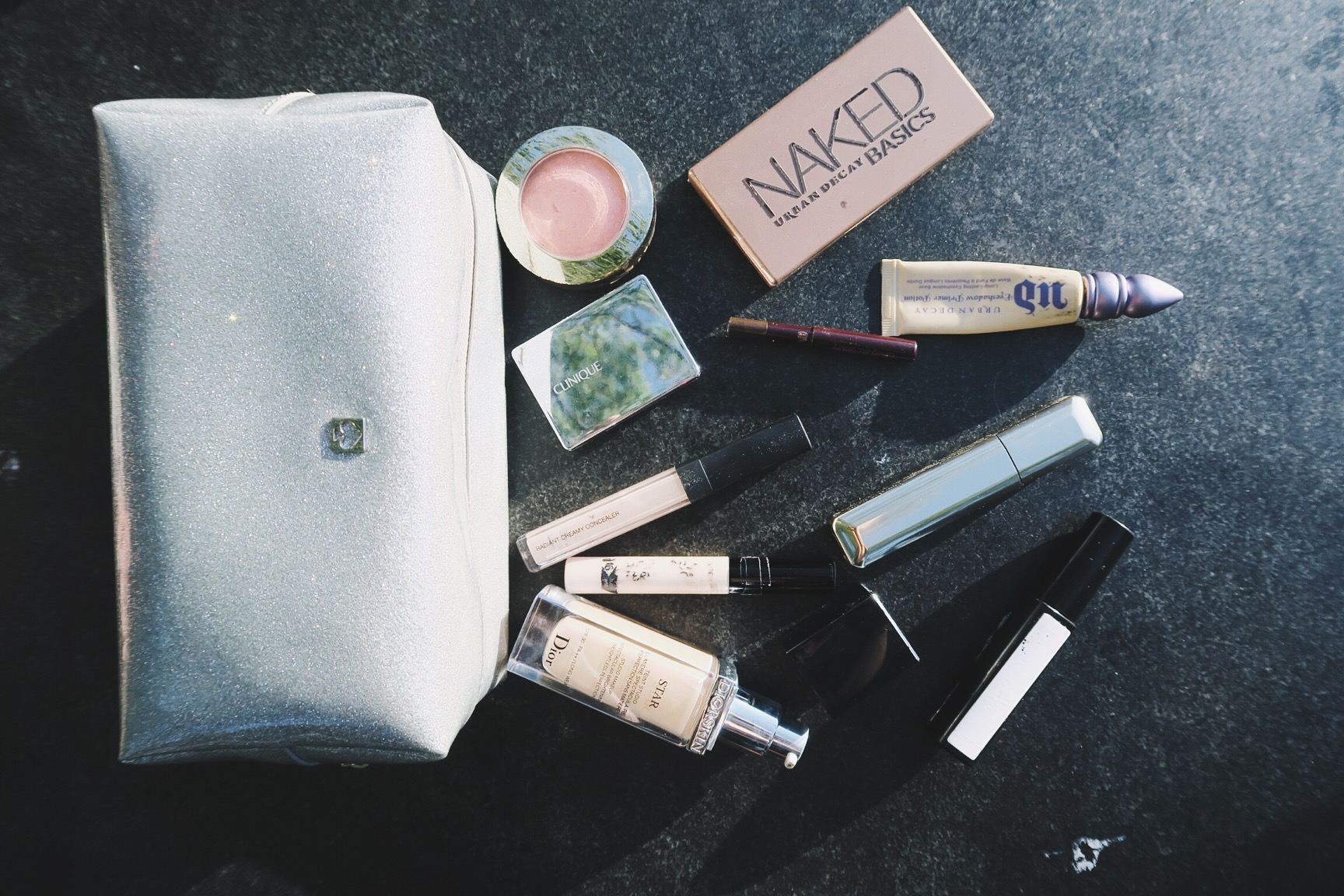 The contents of Anna's travel makeup bag