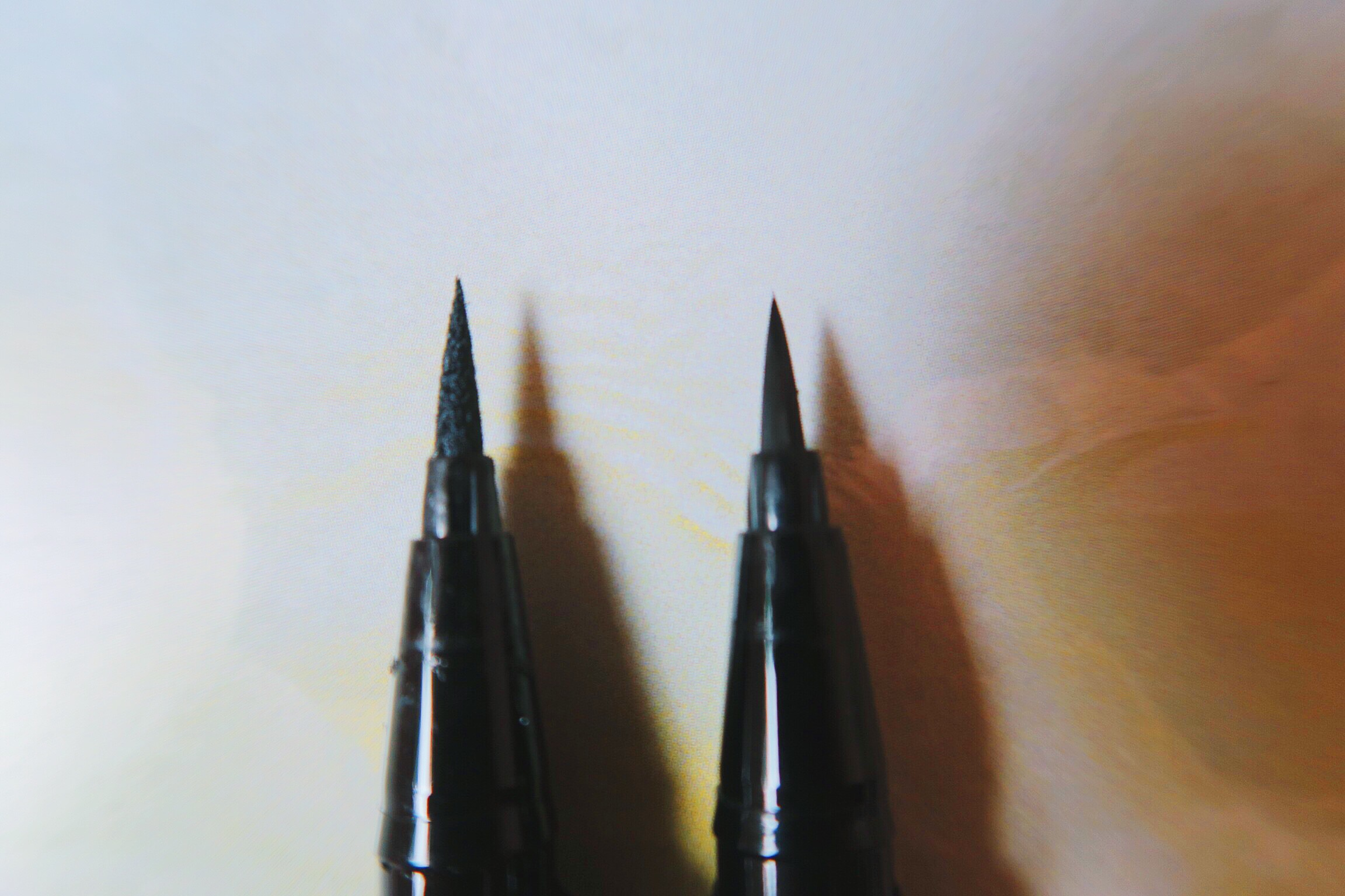 From left to right: Stila Stay All Day Liquid Eyeliner and Kat Von D Tattoo liner