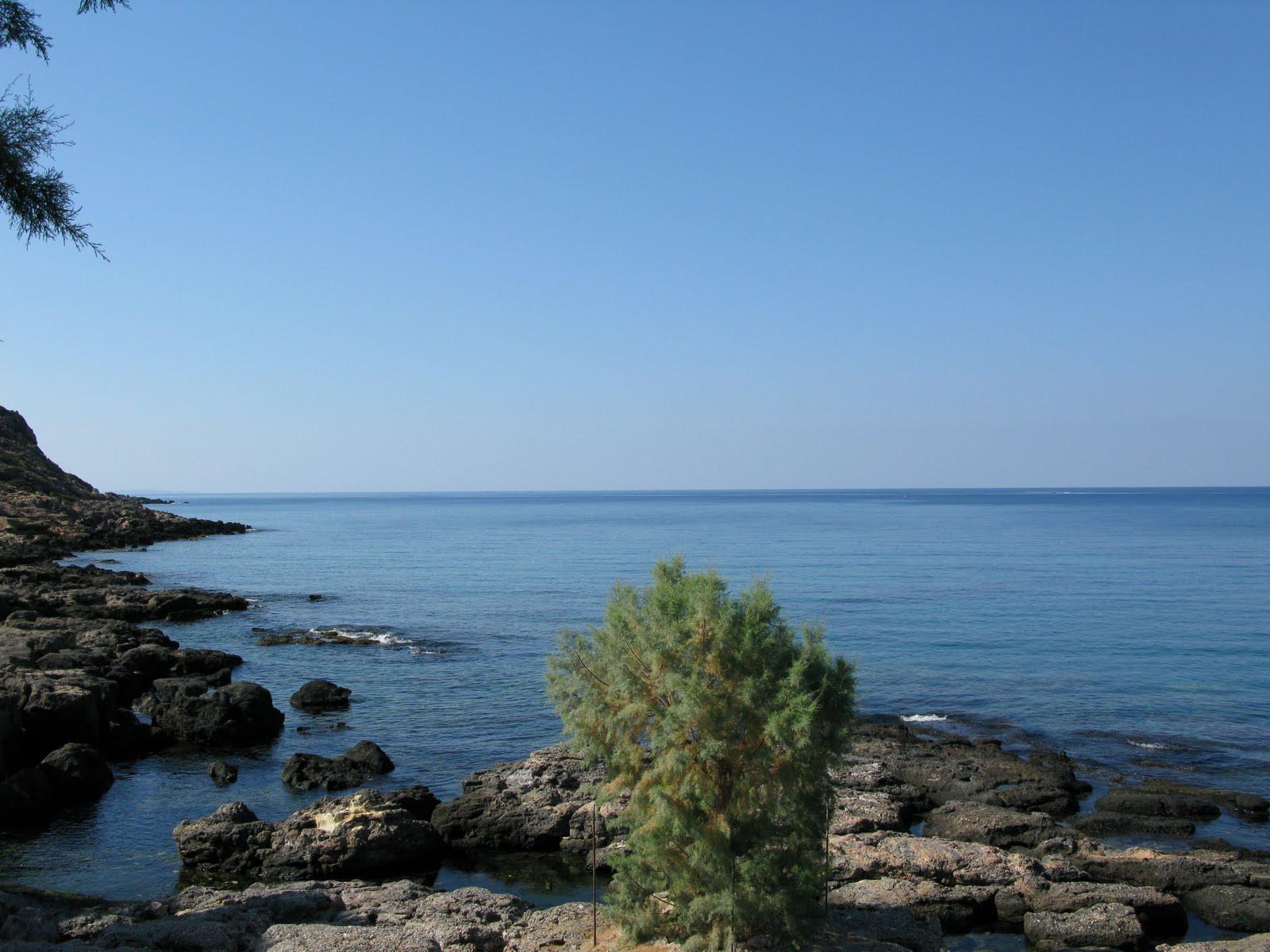 rocky shores along Finikas bay