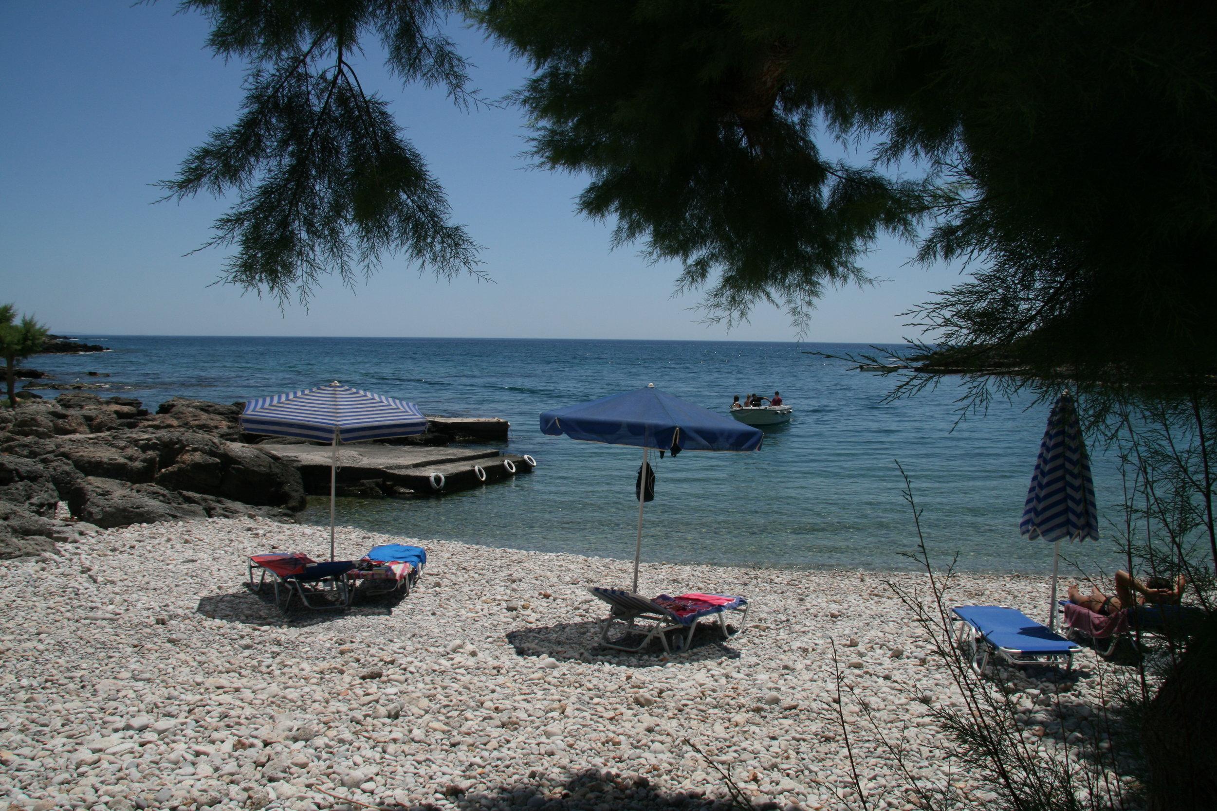 the peble beach of Finikas bay