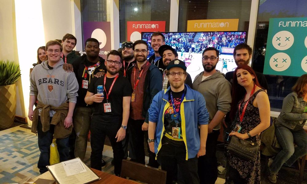 Some of the members doing what they at Creators After Con Network do among the Funimation artifacts.