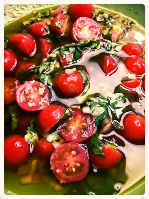 One very finely diced shallot  1/2 cup of excellent olive oil.  We use Domenica Fiore!  1TBS of white wine vinegar  Squeeze of lemon  1 tsp of dijon mustard  Chopped basil  Sliced cherry tomatoes  Salt and Pepper  Let all the ingredients above soak for an hour before tossing with your greens.  Serves 3-4