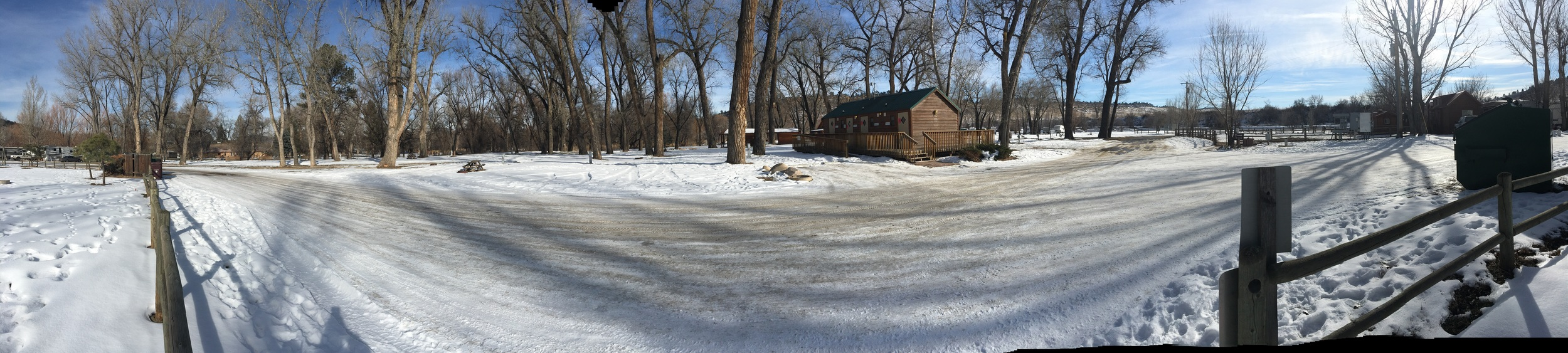 Here's a panorama of the partial hookup area as seen from the big central park. That's the bath/laundry house in the foreground, and the spaces I'm thinking of are behind and slightly left of it.