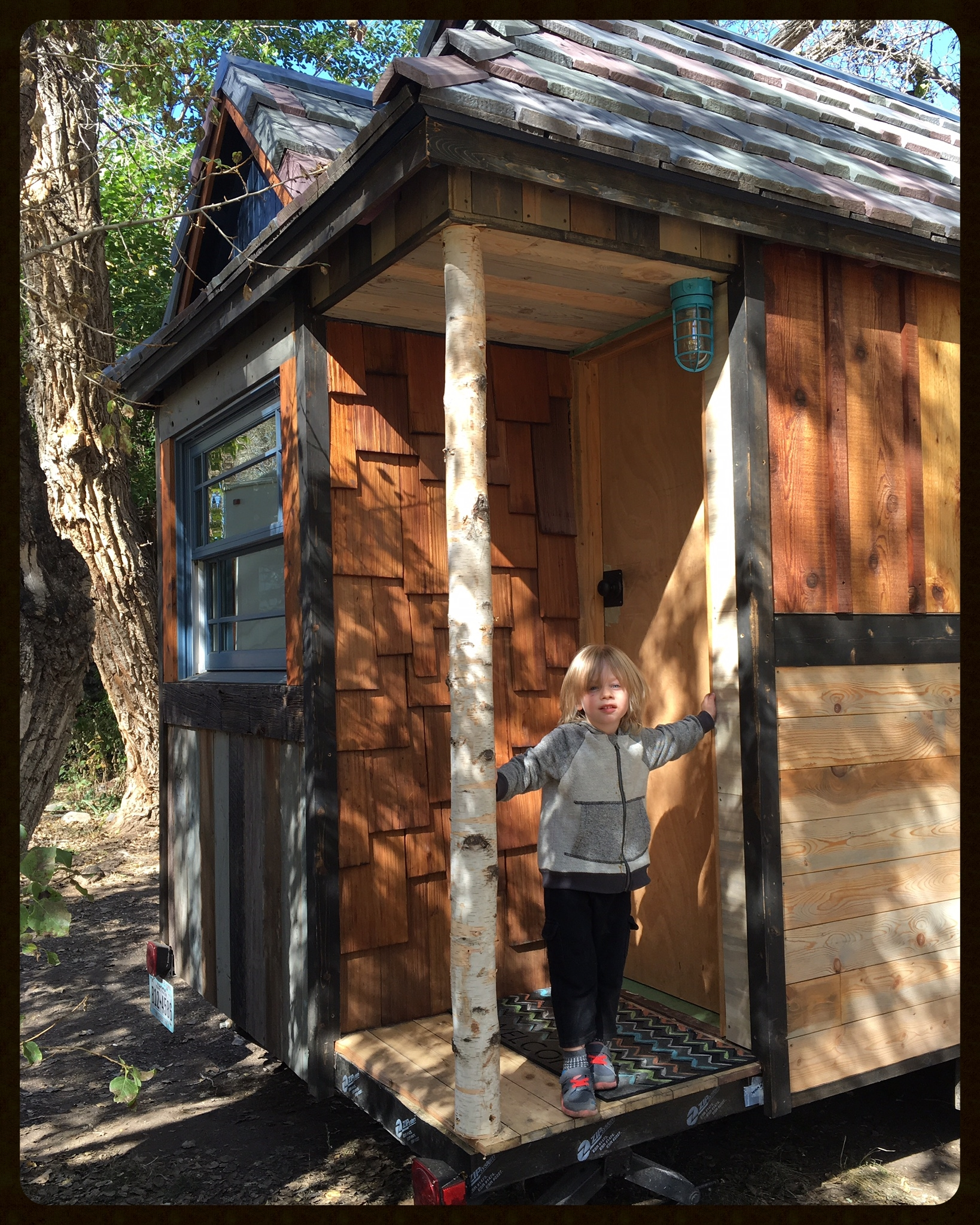 R.A.D posing on the porch at our winter parking spot in Loveland, Colorado. The front door is just temporary and there's more porch trim to complete, but we had fun figuring out the final organizational details inside to make life comfortable in 172sqft plus the loft!<3