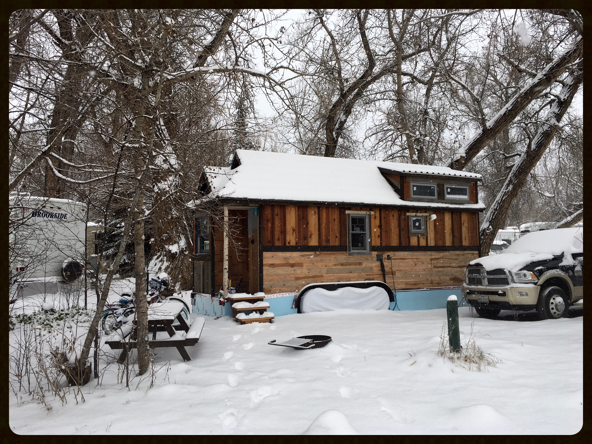 The Tiny House enjoying it's first heavy winter snow in Colorado on Thanksgiving Day. The rigid foam skirt might not be pretty, but it sure helps keep our toes toasty.
