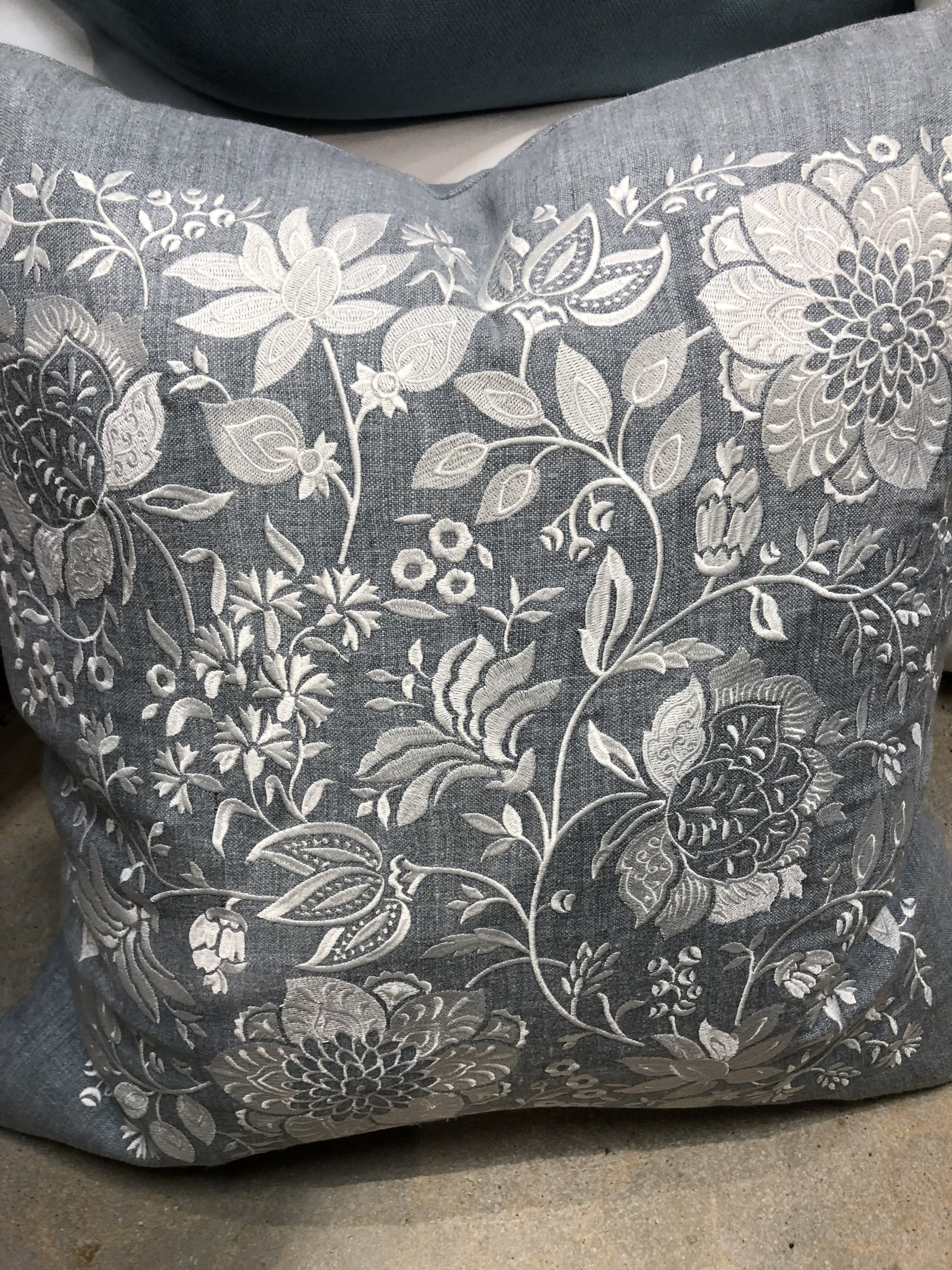 Jacobean embroidered in white on Delave blue linen. This is part of our new collection called French Finds.