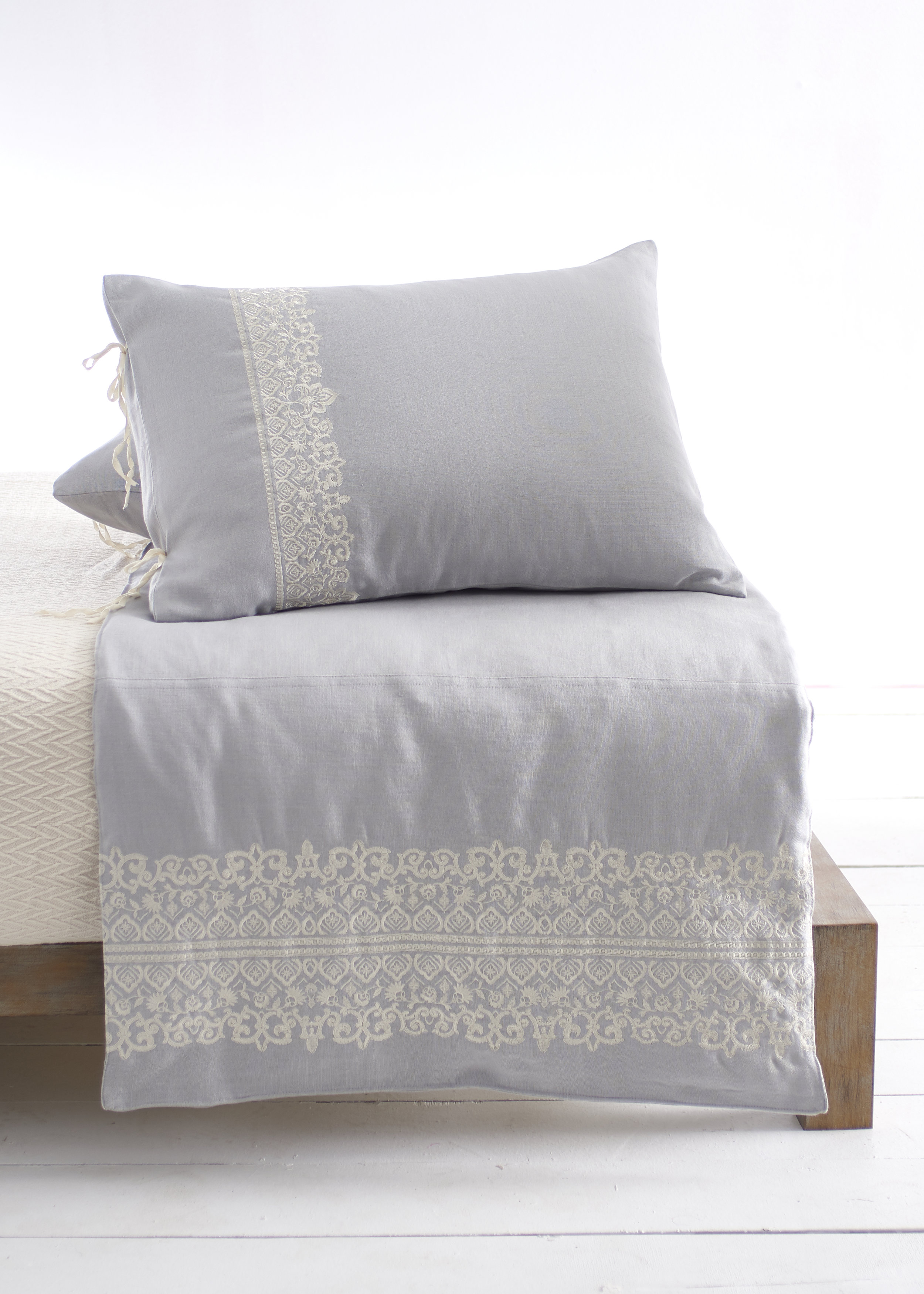 New Item — Marrakesh Counterpane . Our Counterpanes are decorative accents that are about 1/3 the height of a duvet or comforter and are placed at the foot of the bed and have matching shams that can be purchased separately. Counterpanes come in 3 sizes—Twin, Full/Queen, and King. Our Counterpanes are filled with alternative down. Our Marrakesh Counterpane is grey Belgium linen with ivory embroidery and the matching sham has natural twill cotton tie closures.