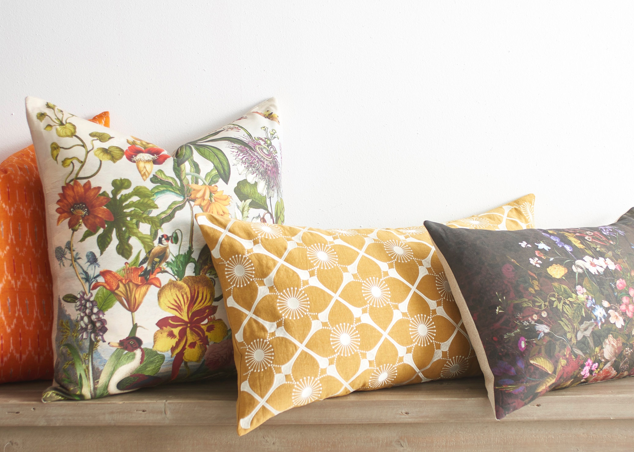 New Toss Pillows —(from left to right) Orange Ikat, Bold Botanical, Daffodil Bolster, and Secret Garden Bolster all come together for a great collection of pattern, texture, and color.