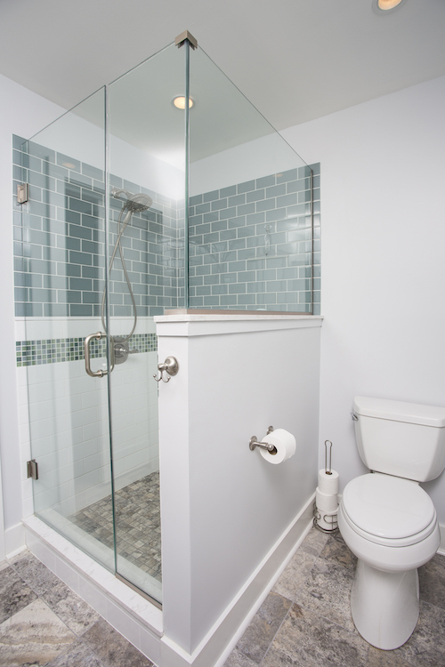 Corner shower with green tile