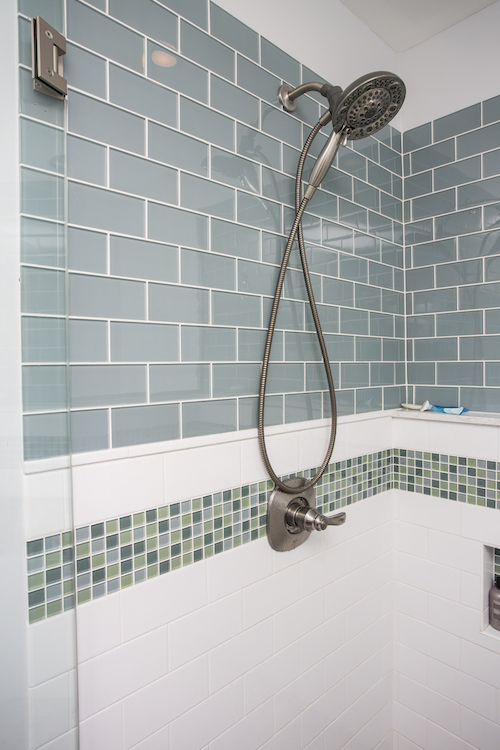 Shower with blue subway tile