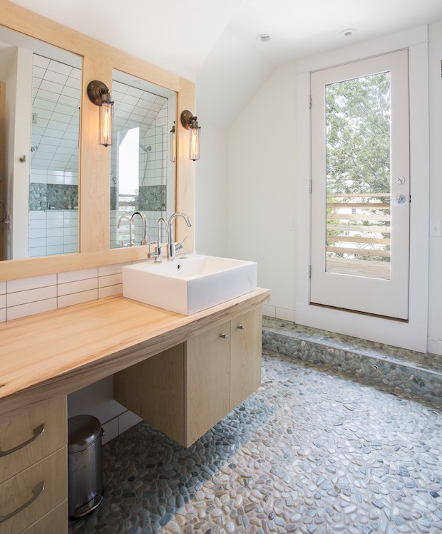 Bathroom with dutch elm countertops and natural stone mosaic