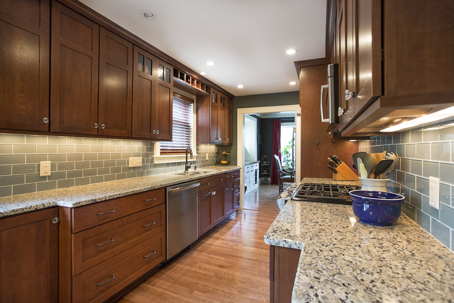 Kitchen with dark brown cabinets