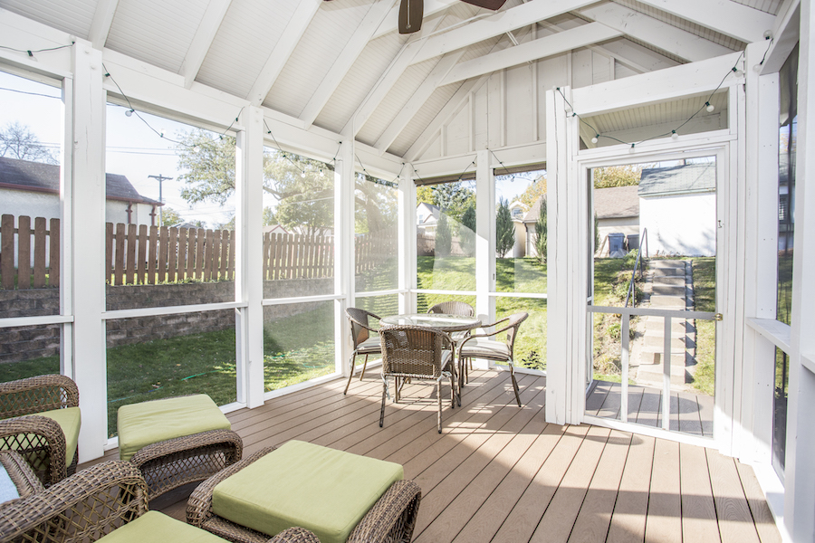 Sunny screened backyard porch