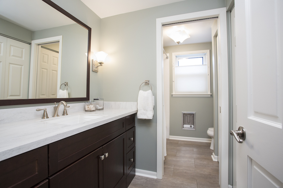Grey bathroom with dark cabinets