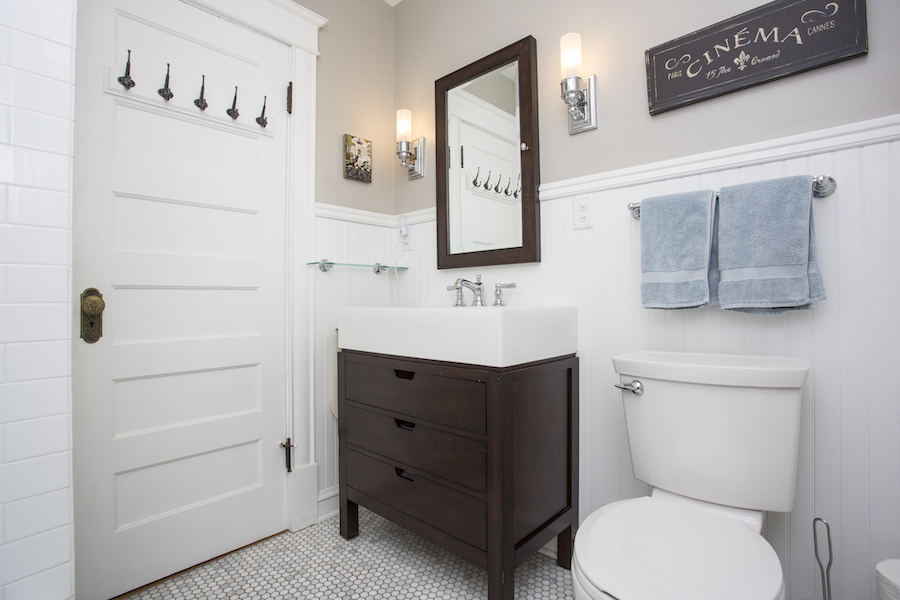 Bathroom with dark cabinet