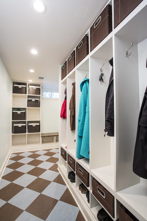 Basement mudroom with marmoleum floor