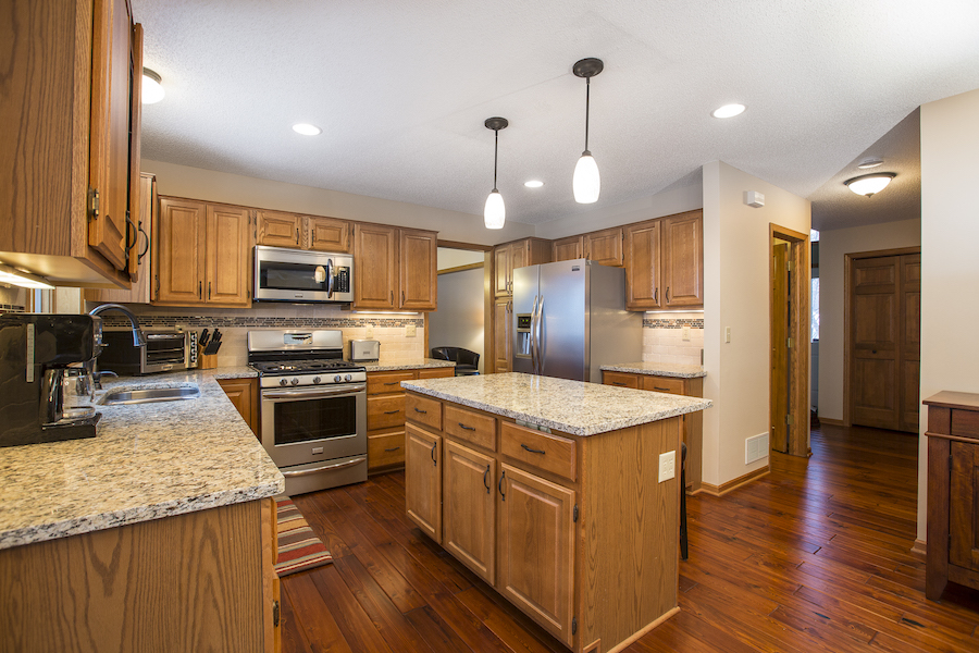 Kitchen with golden oak cabinets