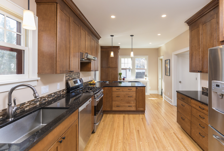 Kitchen with walnut cabinets and black granite countertop