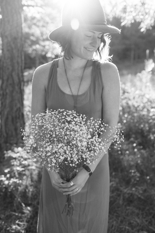 How I think of myself: forever with flowers in my hands and a smile on my face.      Photo credit:  Emily Sacco . Location: Boulder, Colorado.