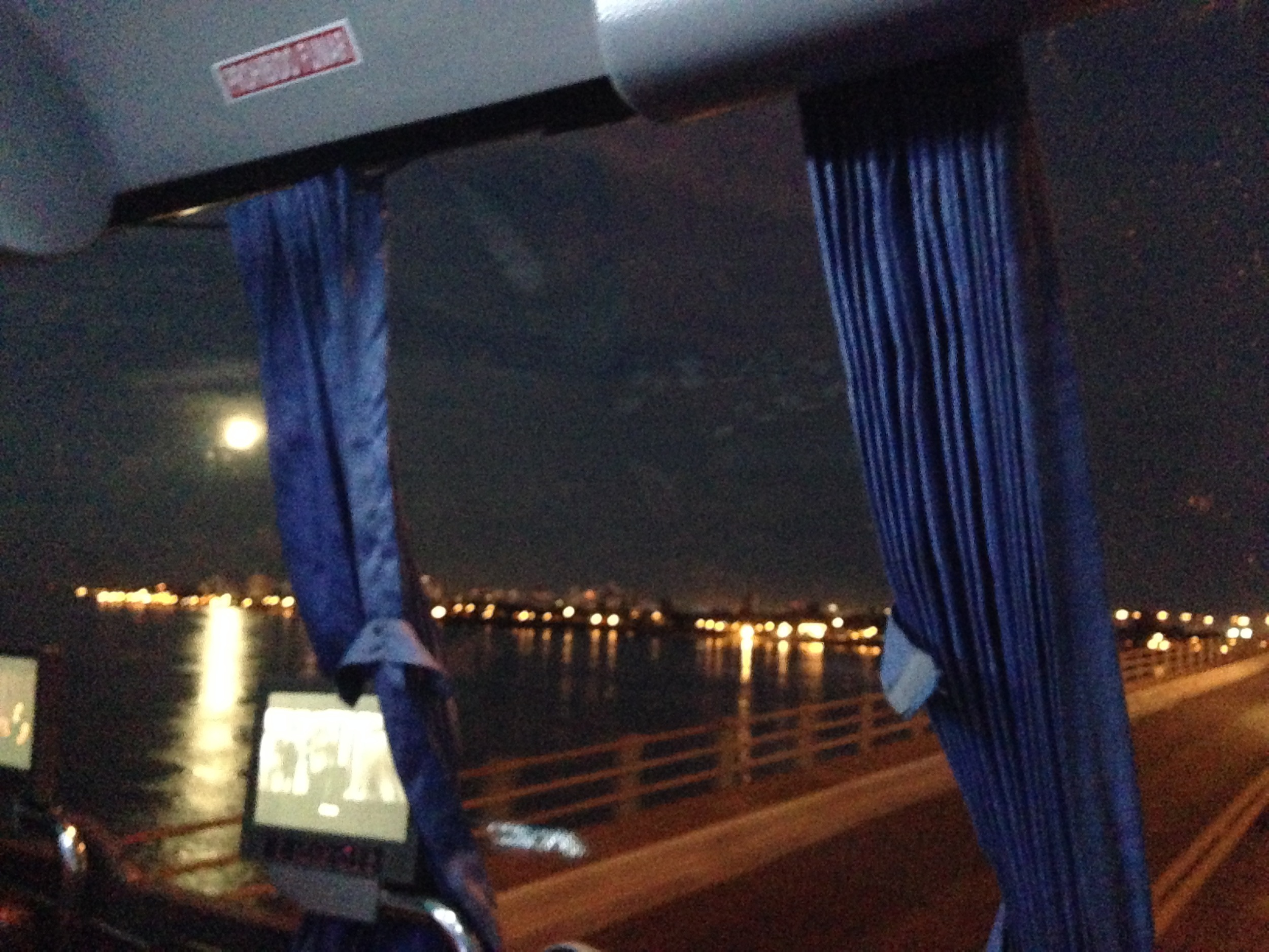 The view from my luxe overnight bus from Resistencia to Buenos Aires. Empanadas, wine, and moon included.