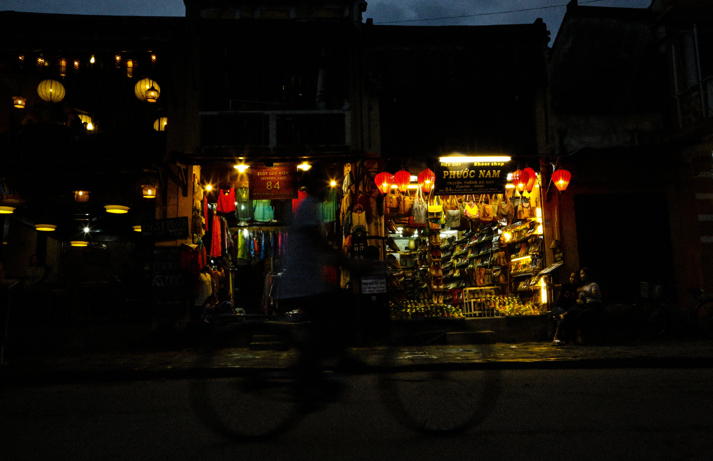 Cyclist late night in Hoi An, Vietnam